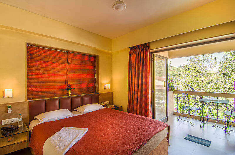 Book Deluxe Room at Hotel Millennium Park, Panchgani